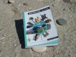 """Couverture du guide de poche """"MONTPELLIER... by tram"""" photographiée à la plage le 9 juin 2012"""