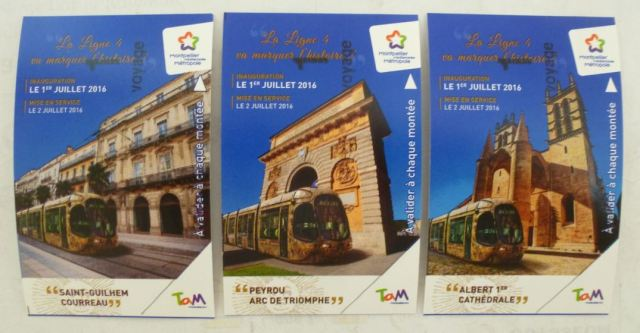 "Les trois tickets collector de la ligne 4 de tramway bouclée symbolisent les trois nouvelles stations mises en service : ""Saint-Guilhem - Courreau"", ""Peyrou - Arc de Triomphe"" et ""Albert 1er - Cathédrale"". Tickets pris en photo par Louis Ferdinand, le jeudi 7 juillet 2016"